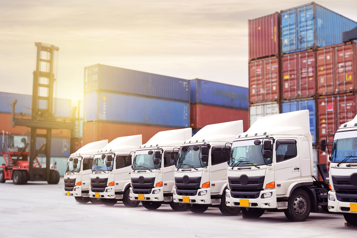 New truck fleet with container depot as for shipping and logistics transportation industry.