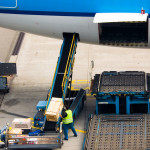 loading cargo on a big plane on airport