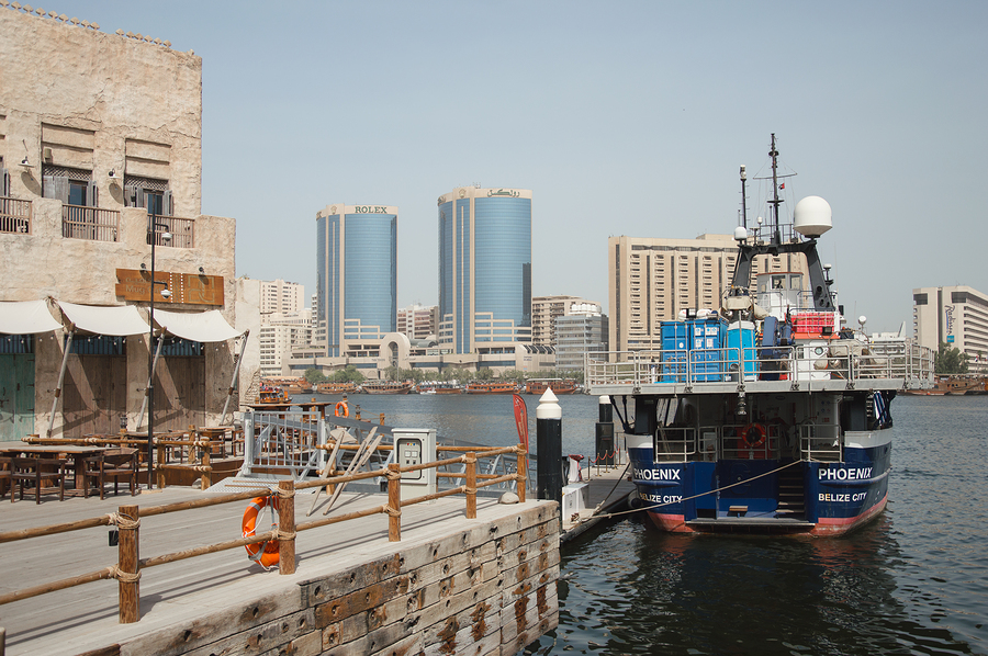 UAE, Dubai - January, 2019: cargo ship at Al Seef area, view over Dubai Creek