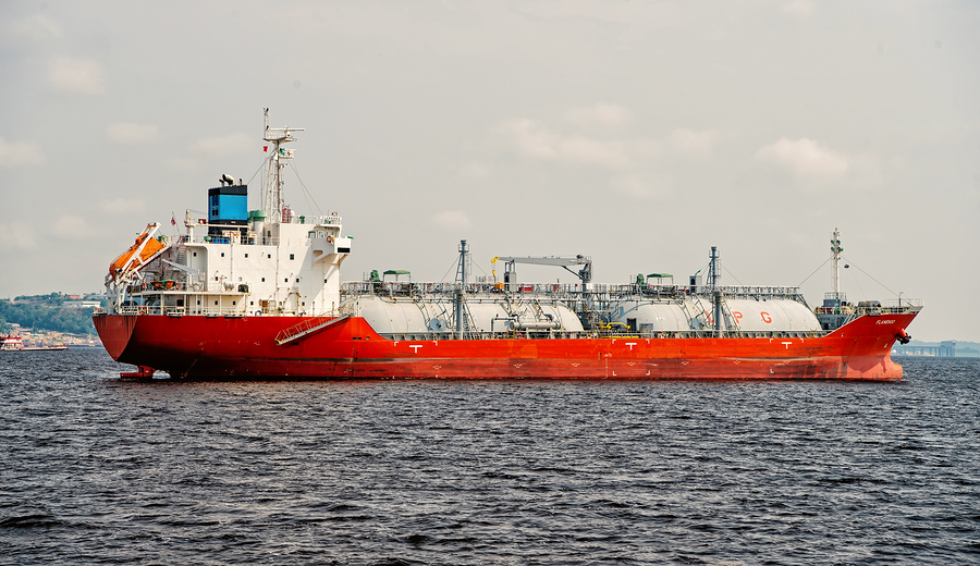 Manaus, Brazil - December 04, 2015: barge shipping cargo in blue sea. Shipment and delivery concept. Ocean transport and transportation. Wanderlust and traveling.